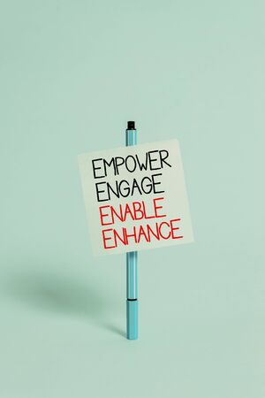 Text sign showing Empower Engage Enable Enhance. Business photo showcasing Empowerment Leadership Motivation Engagement Ballpoint blank colored sticky note peaceful cool pastel fashion background