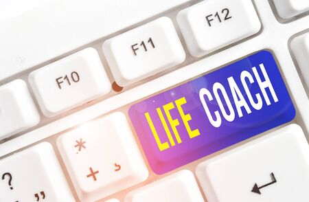 Text sign showing Life Coach. Business photo showcasing A demonstrating who advices clients how to solve their problems or goals White pc keyboard with empty note paper above white background key copy space