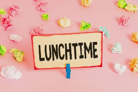 Conceptual hand writing showing Lunchtime. Concept meaning Meal in the middle of the day after breakfast and before dinner Colored crumpled papers empty reminder pink floor clothespin