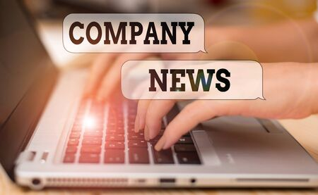 Writing note showing Company News. Business concept for provides news and feature articles about the company status woman with laptop smartphone and office supplies technology