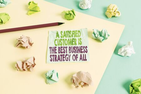Handwriting text A Satisfied Customer is the be. Conceptual photo A Satisfied Customer Is The Best Business Strategy Of All Colored crumpled papers empty reminder blue yellow background clothespin Stock Photo