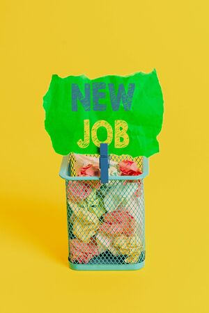Word writing text New Job. Business photo showcasing signing contract Finding work opportunity Seeking better salary Trash bin crumpled paper clothespin empty reminder office supplies yellow