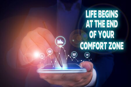 Handwriting text writing Life Begins At The End Of Your Comfort Zone. Conceptual photo Make changes evolve grow Male human wear formal work suit presenting presentation using smart device