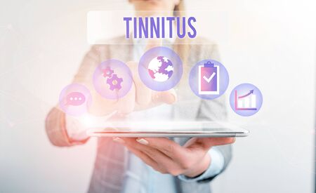 Conceptual hand writing showing Tinnitus. Concept meaning A ringing or music and similar sensation of sound in ears Female human wear formal work suit presenting smart device