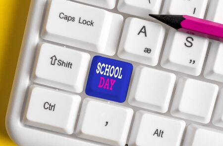 Text sign showing School Day. Business photo text starts from seven or eight am to three pm get taught there White pc keyboard with empty note paper above white background key copy space