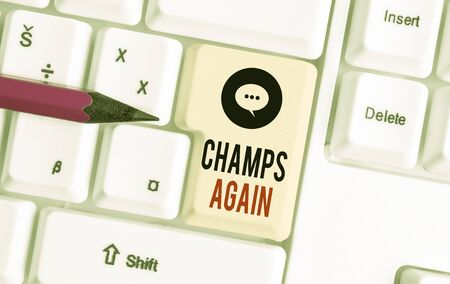 Writing note showing Champs Again. Business concept for refers to winner or someone who excels and enjoys victories White pc keyboard with note paper above the white background