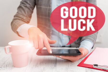 Text sign showing Good Luck. Business photo showcasing A positive fortune or a happy outcome that a demonstrating can have Business woman sitting with mobile phone and cup of coffee on the table