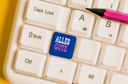 Text sign showing Alles Gute. Business photo text geranalysis translation all the best for birthday or any occasion White pc keyboard with empty note paper above white background key copy space Stock Photo