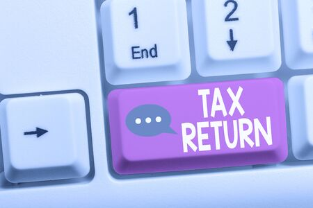 Writing note showing Tax Return. Business concept for which taxpayer makes annual statement of income circumstances White pc keyboard with note paper above the white background