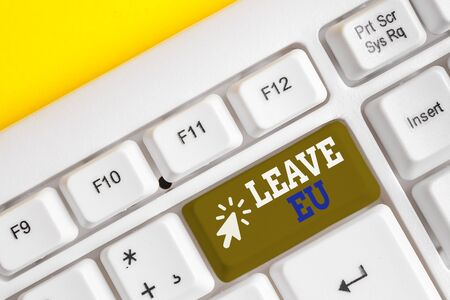 Writing note showing Leave Eu. Business concept for An act of a demonstrating to leave a country that belongs to Europe White pc keyboard with note paper above the white background