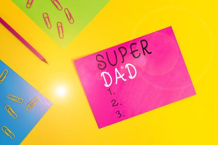 Word writing text Super Dad. Business photo showcasing Children idol and super hero an inspiration to look upon to Blank paper sheets message pencil clips binders plain colored background Stock Photo
