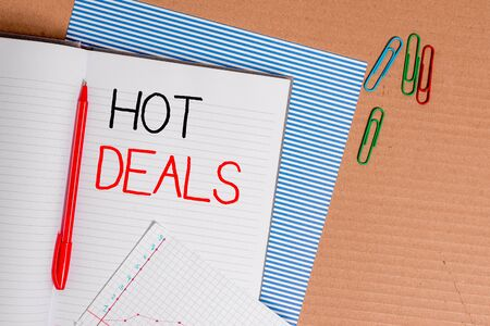 Writing note showing Hot Deals. Business concept for An agreement through which one of the paties is offered and accept Striped paperboard notebook cardboard office study supplies chart paper