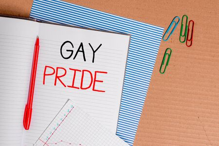 Writing note showing Gay Pride. Business concept for Dignity of an idividual that belongs to either a analysis or woanalysis Striped paperboard notebook cardboard office study supplies chart paper Imagens
