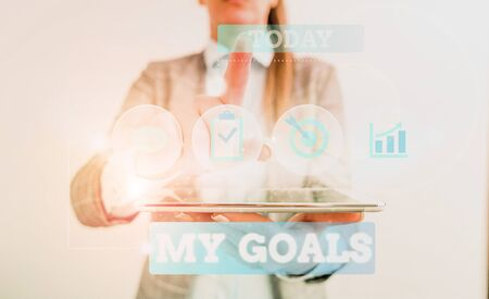 Text sign showing My Goals. Business photo text Future or desired result that a demonstrating commits to achieve Female human wear formal work suit presenting presentation use smart device
