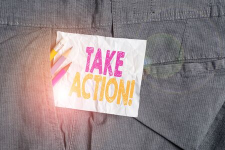 Text sign showing Take Action. Business photo showcasing do something official or concerted to achieve aim with problem Writing equipment and white note paper inside pocket of man work trousers
