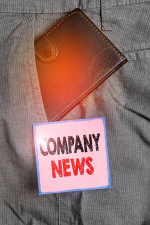Handwriting text writing Company News. Conceptual photo provides news and feature articles about the company status Small little wallet inside man trousers front pocket near notation paper Reklamní fotografie