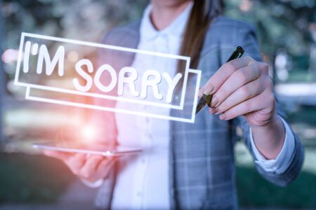 Text sign showing I M Sorry. Business photo showcasing Toask for forgiveness to someone you unintensionaly hurt Outdoor background with business woman holding lap top and pen