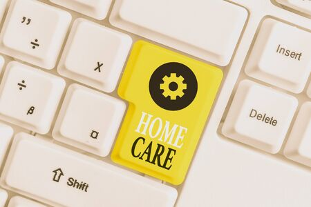 Conceptual hand writing showing Home Care. Concept meaning Place where showing can get the best service of comfort rendered White pc keyboard with note paper above the white background Stock Photo