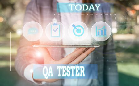 Text sign showing Qa Tester. Business photo showcasing Quality assurance of an on going project before implementation Female human wear formal work suit presenting presentation use smart device 版權商用圖片