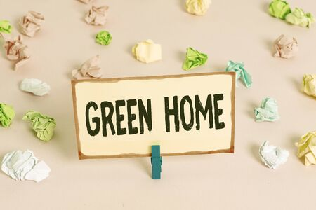Conceptual hand writing showing Green Home. Concept meaning An area filled with plants and trees where you can relax Colored crumpled papers empty reminder pink floor clothespin Stok Fotoğraf