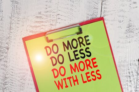 Word writing text Do More Do Less Do More With Less. Business photo showcasing dont work hard work smart be unique Colored clipboard blank paper sheet old retro wooden vintage background Stock Photo