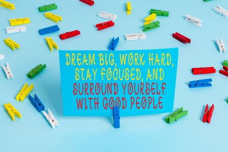 Handwriting text Dream Big Work Hard Stay Focused. Conceptual photo Dream Big Work Hard Stay Focused And Surround Yourself With Good People Colored clothespin papers empty reminder blue floor background office pin