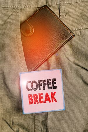 Handwriting text writing Coffee Break. Conceptual photo short time when you stop working to have a cup of coffee Small little wallet inside man trousers front pocket near notation paper Banco de Imagens
