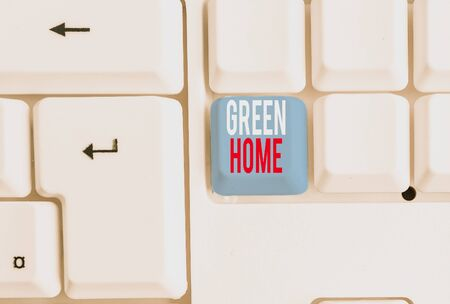 Handwriting text writing Green Home. Conceptual photo An area filled with plants and trees where you can relax White pc keyboard with empty note paper above white background key copy space