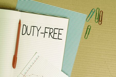Writing note showing Duty Free. Business concept for Store or establisbhement that sells imported products witout tax Striped paperboard notebook cardboard office study supplies chart paper