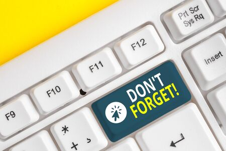 Word writing text Don T Forget. Business photo showcasing used to remind someone about important fact or detail White pc keyboard with empty note paper above white background key copy space