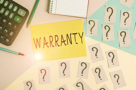 Conceptual hand writing showing Warranty. Concept meaning Free service of repair and maintenance of the product sold Mathematics stuff and writing equipment on pastel background Archivio Fotografico