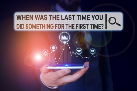 Conceptual hand writing showing When Was The Last Time You Dids. Concept meaning When Was The Last Time You Did Something For The First Time Question Male wear formal suit presenting presentation smar