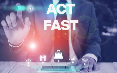Conceptual hand writing showing Act Fast. Concept meaning Voluntarily move in the highest state of speed initiatively Male wear formal suit presenting presentation smart device