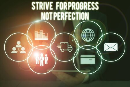 Conceptual hand writing showing Strive For Progress Not Perfection. Concept meaning Improve with flexibility Advance Grow Male wear formal suit presenting presentation smart device