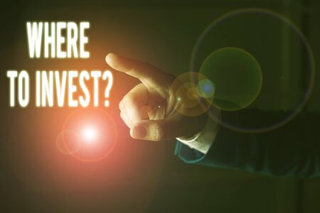 Word writing text Where To Invest Question. Business photo showcasing asking about where put money into financial schemes or shares Isolated hand pointing with finger. Business concept pointing finger