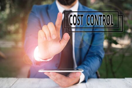 Handwriting text writing Cost Control. Conceptual photo practice of identifying and reducing business expenses Businessman with pointing finger in front of him