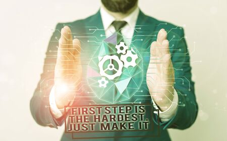 Handwriting text writing First Step Is The Hardest Just Make It. Conceptual photo dont give up on final route Male human wear formal work suit presenting presentation using smart device Foto de archivo - 131361870