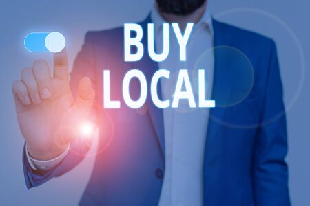 Conceptual hand writing showing Buy Local. Concept meaning Patronizing products that isoriginaly made originaly or native Male wear formal suit presenting presentation smart device