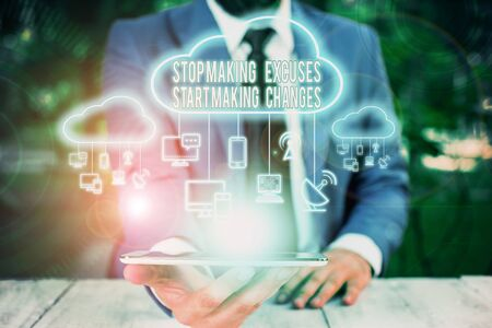 Conceptual hand writing showing Stop Making Excuses Start Making Changes. Concept meaning Do not give an excuse Act instead Male wear formal work suit presenting presentation smart device