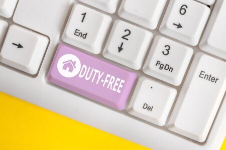Word writing text Duty Free. Business photo showcasing Store or establisbhement that sells imported products witout tax White pc keyboard with empty note paper above white background key copy space Banco de Imagens
