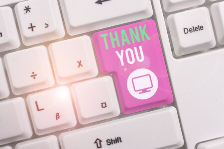 Text sign showing Thank You. Business photo text replaying on something good or greetings with pleased way White pc keyboard with empty note paper above white background key copy space