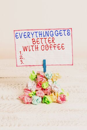 Conceptual hand writing showing Everything Gets Better With Coffee. Concept meaning Have a hot drink when having problems Reminder pile colored crumpled paper clothespin wooden space