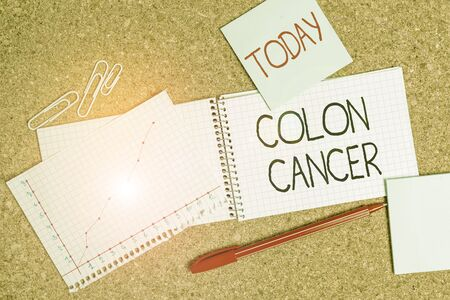 Writing note showing Colon Cancer. Business concept for the development of cancer cells from the colon or rectum Desk notebook paper office paperboard study supplies chart