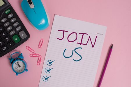 Writing note showing Join Us. Business concept for Register in community Team or blog Sign up at social media Calculator clips alarm clock mouse sheet pencil colored background