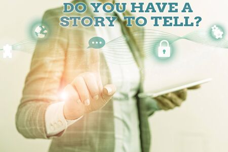 Word writing text Do You Have A Story To Tell Question. Business photo showcasing Storytelling Memories Tales Experiences Female human wear formal work suit presenting presentation use smart device Фото со стока