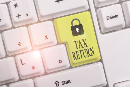 Text sign showing Tax Return. Business photo text which taxpayer makes annual statement of income circumstances White pc keyboard with empty note paper above white background key copy space