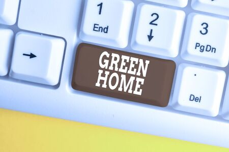 Conceptual hand writing showing Green Home. Concept meaning An area filled with plants and trees where you can relax White pc keyboard with note paper above the white background Stock fotó