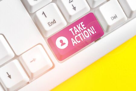 Writing note showing Take Action. Business concept for do something official or concerted to achieve aim with problem White pc keyboard with note paper above the white background Stock fotó