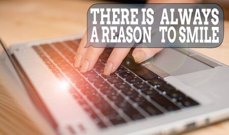 Writing note showing There Is Always A Reason To Smile. Business concept for Positive thinking good attitude energy woman with laptop smartphone and office supplies technology