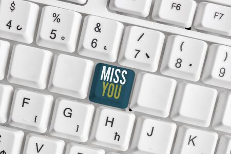 Handwriting text Miss You. Conceptual photo Longing for an important demonstrating in your life for a period of time White pc keyboard with empty note paper above white background key copy space Reklamní fotografie